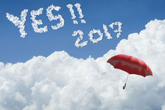 Red umbrella floating above against Blue sky and cloud.Sunny day.Cloudscape.close up the cloud.text YES 2017. hope to success Royalty Free Stock Photography