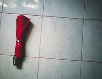 Red Umbrella on the floor. royalty free stock photography