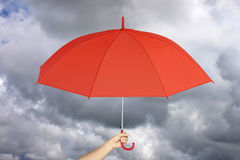 Red umbrella in hand and rain protection. Stock Photography