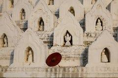 Hsinbyume Pagoda Mingun in Mandalay, Myanmar. A red umbrella at Hsinbyume Mya Thein Dan pagoda at sunny day in Mingun, Mandalay, Myanmar. Hsinbyume is a Royalty Free Stock Photo