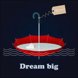 Red umbrella, little paper ship and inspiring lettering Dream big Royalty Free Stock Photos
