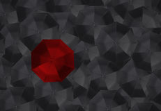 Red umbrella and many black umbrellas. Royalty Free Stock Image