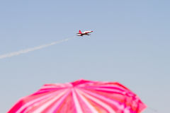 Red Umbrella and Military Airplane Royalty Free Stock Image