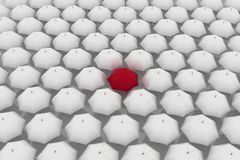 Red umbrella among other white umbrellas Royalty Free Stock Image