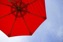 Red umbrella over sky Stock Image