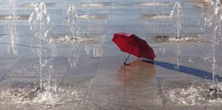 Red umbrella. A picture of  red umbrella in small  waterfountains,in a greek town thessaloniki Royalty Free Stock Photo