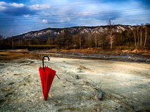 Red umbrella project, give the world some color. This photo was designed to raise awareness about the pollution of the river in the vicinity of the town of Bor Royalty Free Stock Photography
