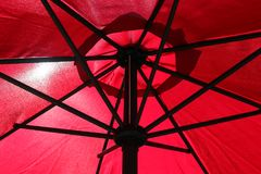 A red umbrella that protects good Royalty Free Stock Photos