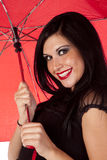 Red umbrella and red lipstick Royalty Free Stock Images