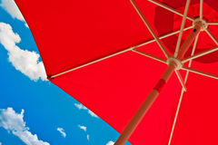 Red umbrella for shading. For shading lon a blacony Stock Image