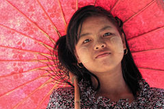 Red Umbrella and a shy smile Royalty Free Stock Image
