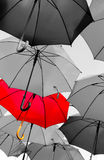 Red umbrella standing out royalty free stock image