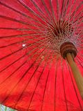 Bamboo leaves in old red umbrella Royalty Free Stock Photos