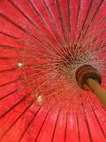 Bamboo leaves in old red umbrella Stock Photos