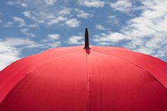 Red Umbrella in Sunny Day. And beautiful cloud and blue sky Royalty Free Stock Photo