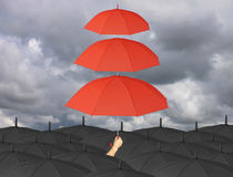 Red umbrella third layers in hand and rain protection more than Royalty Free Stock Photo