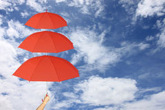 Red umbrella third layers in hand and Sun protection more than. Royalty Free Stock Photography