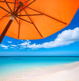 Red umbrella on  tropical beach. Travel  background Stock Images