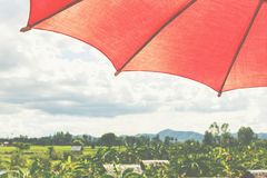 Red umbrella under sky. Stock Image