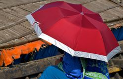 Woman is Sitting with an Umbrella Stock Photograph Stock Images