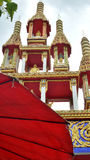 Red umbrella of vendor in fresh market infront of temple entrance Royalty Free Stock Photo