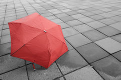 Red umbrella on the wet floor Stock Images