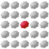 Red umbrella among white Stock Photography