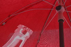 Red umbrella under the sun stock photography