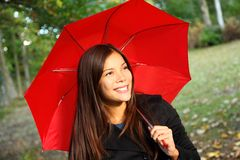 Red umbrella woman. Outdoors in autumn forest. Beautiful model Stock Image
