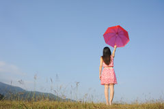 Red umbrella woman see sky Royalty Free Stock Photo