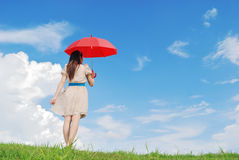 Red umbrella woman wait for someone and cloud sky Royalty Free Stock Photo