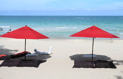 Red umbrellas on the beach Royalty Free Stock Image