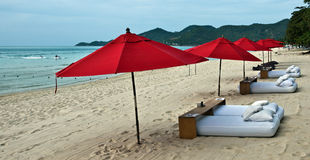 Red umbrellas at the beach Stock Photography