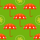 Red umbrellas on green background seamless pattern. Vector seaml Stock Photos