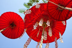 Red umbrellas. On sky background royalty free stock photo
