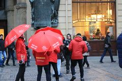 Red umbrellas on the streets of Prague stock photography