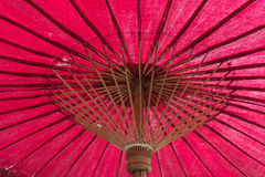 Red unbleached cloth Handcraft umbrella. Under of Red unbleached cloth Handcraft umbrella Stock Photos