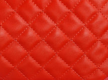 Red upholstery. Texture pattern background stock photos