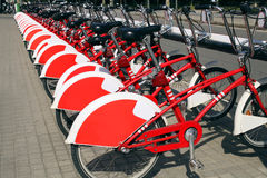 Red urban bicycles parked in european city Stock Photo