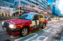 Red Urban Taxi, Hong Kong. Taxis need a license to operate in Hong Kong. The service area of the three types of taxis are defined by the Government. This is the Stock Photography