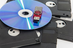 Red usb drive put on cd and have disket under them. royalty free stock images