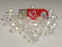 Red USB flash drive with heart and gems closeup Royalty Free Stock Photo