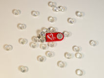 Red USB flash drive with hearts and gems Stock Photo