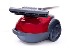 Red vacuum cleaner and brush Stock Photos
