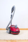 Red vacuum cleaner. Royalty Free Stock Photos
