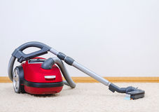 Red vacuum cleaner. Royalty Free Stock Image