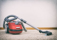 Red vacuum cleaner. Stock Image