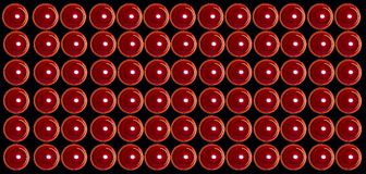 Red valentine candles at black background royalty free stock images