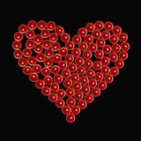 Red valentine candles as heart at black stock photos