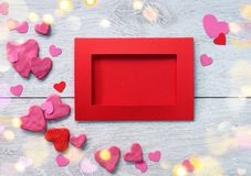 Red valentine card with heart shaped on white wooden table. Top view. Valentines Day concept Stock Photography
